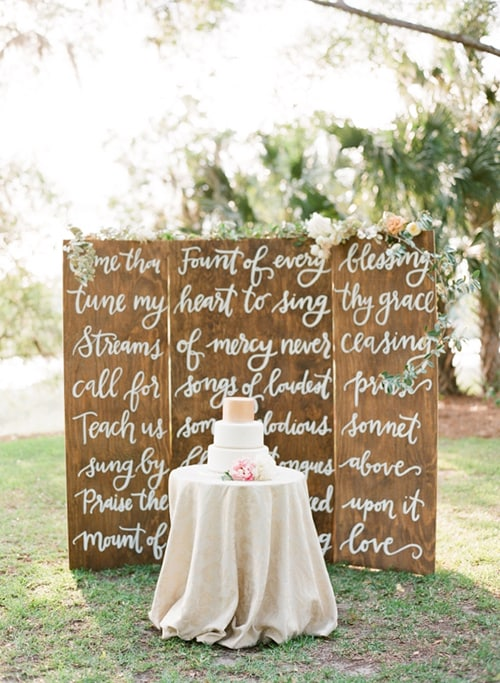 wedding dessert backdrops with calligraphy